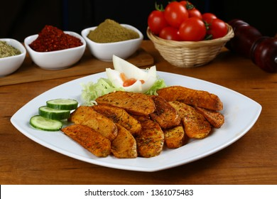 Fried potato wedges with paprika on plate