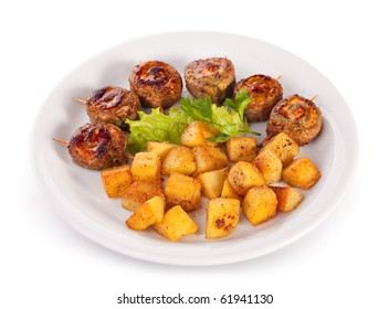 Fried potatoes with juicy beef roll; isolated on white with clipping path