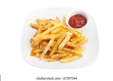 Fried potatoes with ketchup on plate.