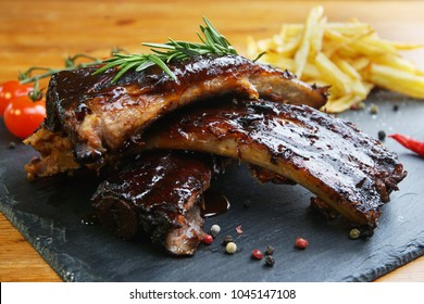 fried potatoes and pork ribs  plate