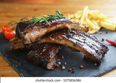 fried potatoes and pork ribs  plate