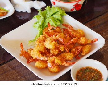 Fried prawn balls on the wooden table.