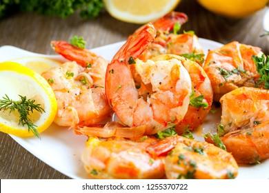 Fried prawns with fresh rosmarin and lemon juice