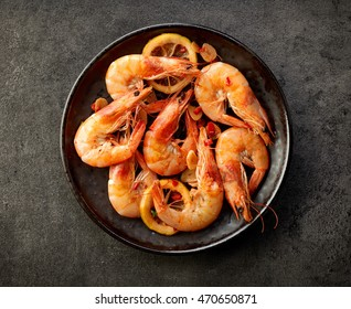 fried prawns on black plate, top view