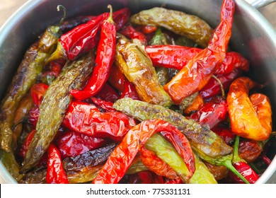 Fried red and green chilies with selective focus and copy space