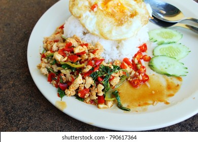 Fried rice with basil chicken and egg fried