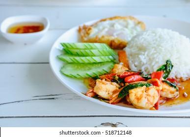Fried rice with basil shrimp and fired egg. Selective focus shrimp, Popular thai food