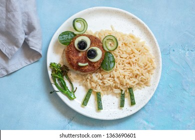 Fried rice and burger lunch for kids look like funny sheep