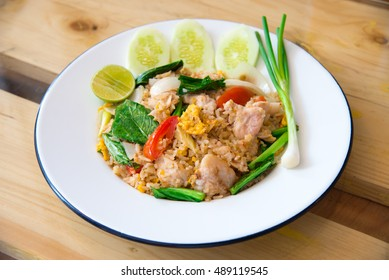 Fried rice is a Chinese dish of steamed rice that has been stir-fried in a wok and, usually, mixed with other ingredients, eggs, vegetables, and meat, and as such, often served as a complete dish.