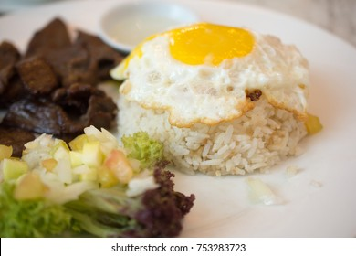 Fried rice with egg, black pepper meat and salad