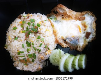fried rice with fried egg and sliced cucumber