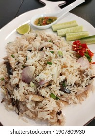 Fried rice with fish, Thai style eat with chilli and vegetables.