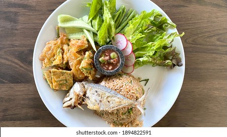 Fried rice with fried mackerel fish and mix vegetable dipping in Thai style