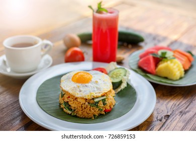 Fried rice Nasi goreng with chicken, shrimp and vegetables close-up horizontal