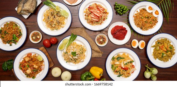 fried rice in plate on wooden table in restaurant