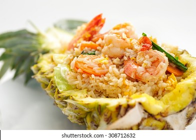 Fried rice with seafood served in a pineapple isolated on white