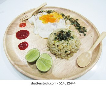 Fried rice serve with fried egg and lemon