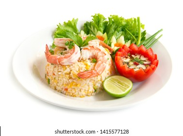 Fried rice with shrimp decorate with vegetables carved Chinese and Thai food fusion style popular menu in Thailand side view isolated on white background