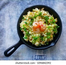 Fried rice with shrimp in a pan. Top view
