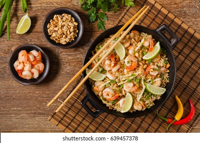 Fried rice with shrimp in Thai. Prepared in wok. Top view.