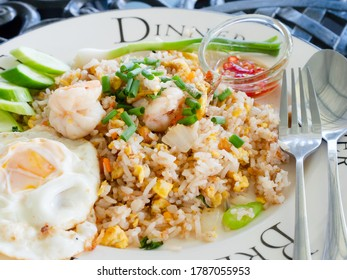 Fried rice with shrimps, the traditional Thai food with fried egg and prik nam pla, fish sauce with chili pepper, at a restaurant in Pattaya, Thailand.