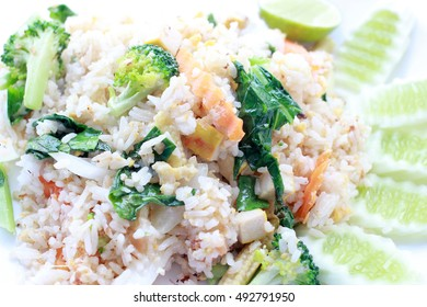 fried rice with vegetable on the white plate with withe background. Vegetarian Food, healthy food, Thai cuisine