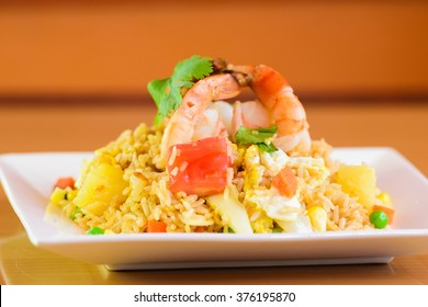 fried rice with yellow curry with shrimp, Thai food on white dish