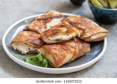 Fried Rolled Crepes with ham and cheese