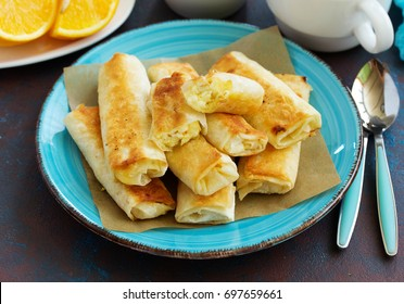 Fried rolls with dough filo and cheese curd cheese filling.