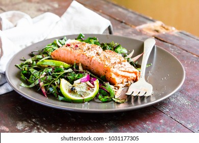 Fried Salmon steak with fresh vegetables salad, concept healthy food.