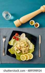 fried salted cod fish with lemon and cherry tomatoes, traditional italian dish