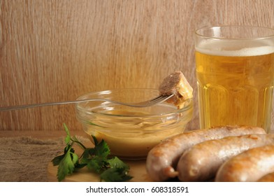 The fried sausages and glasses of light or dark beer, pub and bar concept