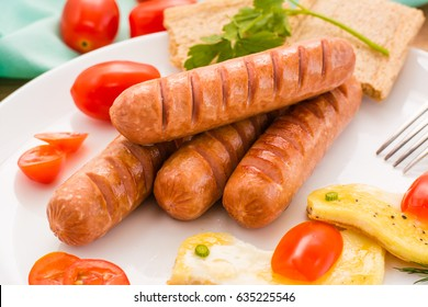 Fried sausages on a plate