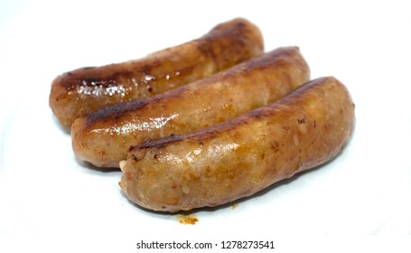 Fried sausages on white