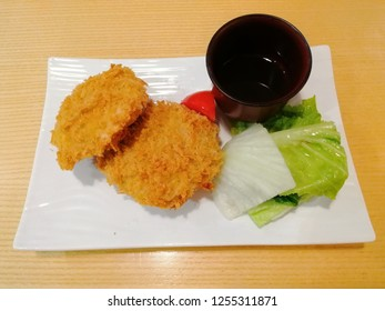 Fried Pumkin with Japanese sause and vegetable.