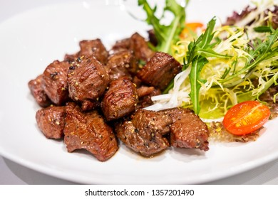 Fried sauteed beef tenderlion cubes with black pepper
