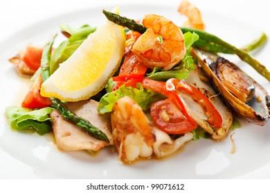 Fried Seafood Salad with Lemon Slice and Asparagus