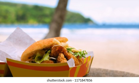 Fried shark and bake fast food by the beach at Maracas Bay, local traditional Caribbean cuisine tasty and flavourful fried shark meat dressed in a variety of sauces.