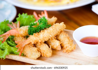 Fried shrimp ball or Tempura Shrimps in wood plate on the table