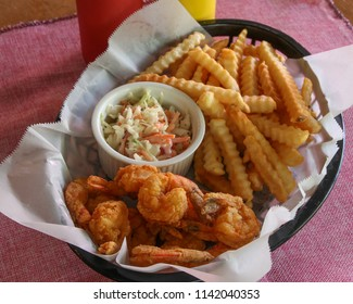 Fried Shrimp basket with a side of crinkle fries and cole slaw.