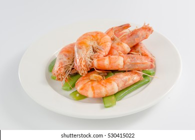 Fried shrimp in a plate isolated on white background