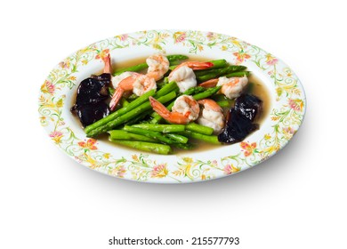 Fried shrimp / prawn with asparagus and vegetable in oyster sauce on white background.