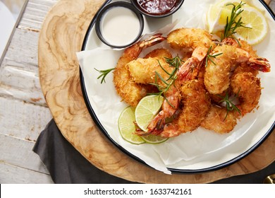 Fried Shrimp with Sauce. Shrimp tempura and salad of fresh vegetables close-up on a plate on a table.