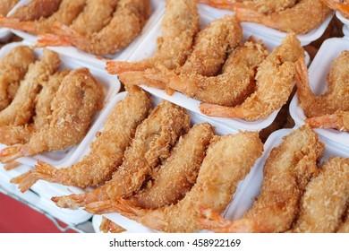 fried shrimp in styrofoam plate