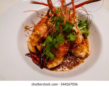 fried shrimp with sweet source on the white dish at thai restaurant. it is spicy food and yummy in thailand