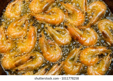 fried shrimps in a frying pan