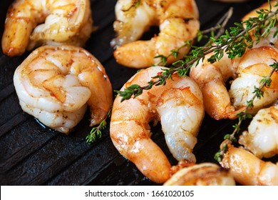 Fried shrimps with herbs, close up view