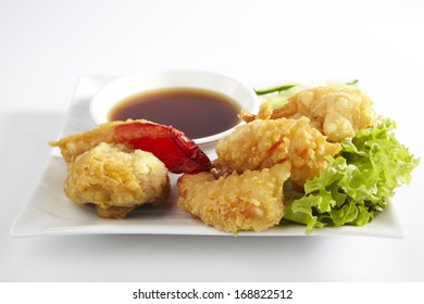 Fried Shrimps, on plate with sauce
