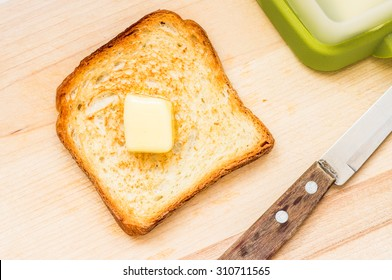 Fried slice of toast with butter top view