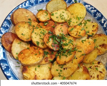 Fried sliced potatoes with green onions